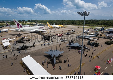 Singapore 16 Feb 2016: Fighter jets, passenger aircraft and more at the static aircraft display at the Singapore Airshow 2016. This is a biennial event and is the largest of its kind in Asia. - stock photo