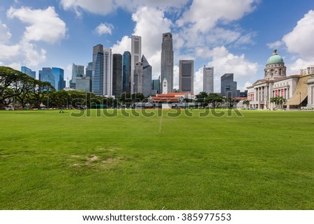 Singapore, 26 Feb 2016: Morning view of city skyline with green fields. - stock photo
