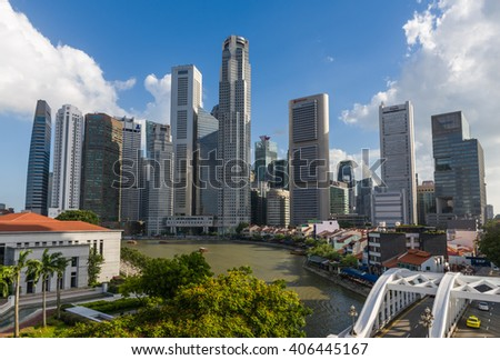 Singapore, 25 Feb 2016: Singapore River with towering skyscrapers. - stock photo