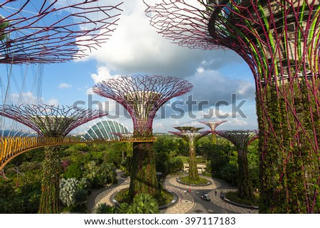 SINGAPORE - FEB 19, 2016: View of Gardens by the Bay. Gardens by the Bay is a nature park spanning 101 hectares (250 acres) of reclaimed land in central Singapore, adjacent to the Marina Reservoir. - stock photo