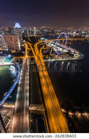 SINGAPORE - FEBRUARY 27, 2015: aerial view of Benjamin Sheares bridge, Helix bridge and Singapore Flyer at Marina Bay, Singapore. Marina Bay is one of the most famous tourist attraction in Singapore.  - stock photo