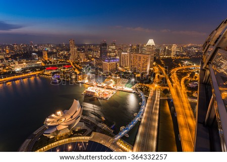 SINGAPORE - FEBRUARY 27, 2015: aerial view of sunset scene of Marina Bay. Marina Bay is one of the most famous tourist attraction in Singapore.  - stock photo