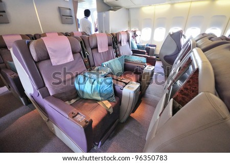 SINGAPORE - FEBRUARY 17: Business class cabin in Singapore Airlines' (SIA) last Boeing 747-400 aircraft at Singapore Airshow on February 17, 2012 in Singapore - stock photo