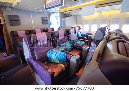 SINGAPORE - FEBRUARY 12: Business class seats in Singapore Airlines' (SIA) last Boeing 747-400 aircraft at Singapore Airshow February 12, 2012 in Singapore - stock photo
