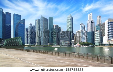 SINGAPORE - FEBRUARY 04, 2014: Downtown Singapore from Marina Bay. View includes next buildings: Louis Vuitton Island, DBC, HSBC, Maybank, Capital Tower, OUB Centre, UOB Plaza1, OSBC, SingTel and ect  - stock photo