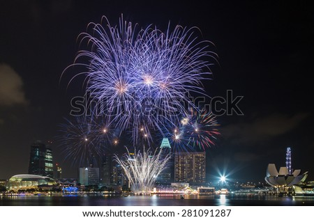 SINGAPORE â?? FEBRUARY 19 2015: Fireworks display over the Marina Bay waterfront in celebration of the Lunar New Year  - stock photo