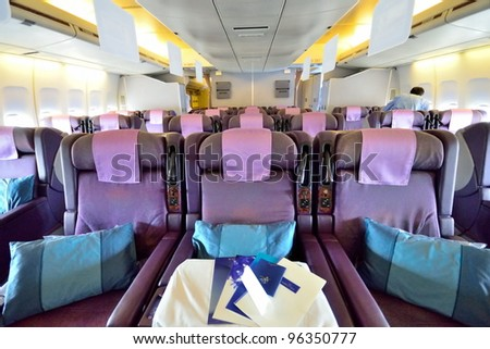SINGAPORE - FEBRUARY 17: Front view of spacious business class seats in Singapore Airlines' (SIA) last Boeing 747-400 aircraft at Singapore Airshow on February 17, 2012 in Singapore - stock photo