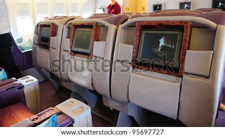 SINGAPORE - FEBRUARY 12: Inflight entertainment system of business class cabin in Singapore Airlines' (SIA) last Boeing 747-400 aircraft at Singapore Airshow February 12, 2012 in Singapore - stock photo