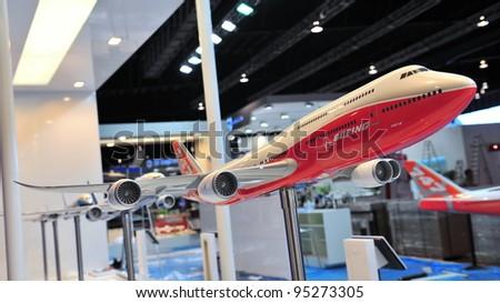 SINGAPORE - FEBRUARY 12: Model of Boeing 787-800 jumbo jet on display at Singapore Airshow February 12, 2012 in Singapore - stock photo