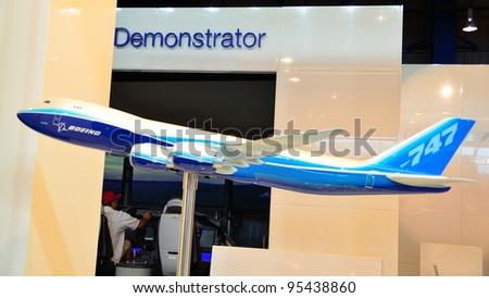 SINGAPORE - FEBRUARY 12: Model of Boeing 747-800 jumbo jet on display at Singapore Airshow February 12, 2012 in Singapore - stock photo