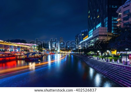 Singapore - FEBRUARY 2, 2015: Night at Clarke Quay. Clarke Quay is a historical riverside quay in Singapore - a popular touristic destination and night life center - stock photo
