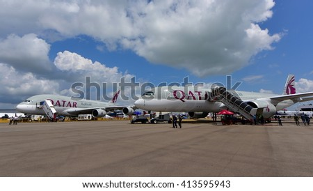 SINGAPORE - FEBRUARY 16:  Qatar Airways Airbus A380 and A350-900 XWB on display at Singapore Airshow February 16, 2016 in Singapore - stock photo