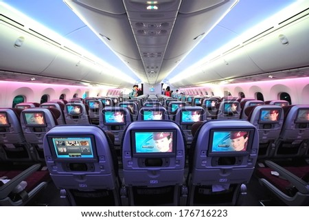 SINGAPORE - FEBRUARY 12: Qatar Airways' Boeing 787-8 Dreamliner economy class cabin and inflight entertainment system (IFE) at Singapore Airshow February 12, 2014 in Singapore - stock photo