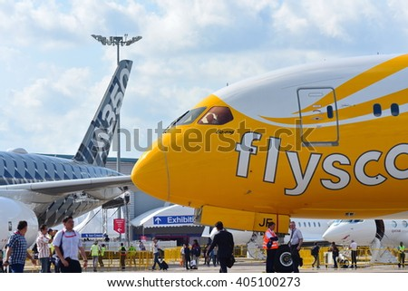 SINGAPORE - FEBRUARY 16:  Scoot Boeing 787 Dreamliner parked next to rival Airbus A350-900 XWB at Singapore Airshow February 16, 2016 in Singapore - stock photo