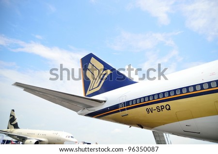 SINGAPORE - FEBRUARY 17: Singapore Airlines' (SIA) Boeing 747-400 tailplane at Singapore Airshow on February 17, 2012 in Singapore - stock photo