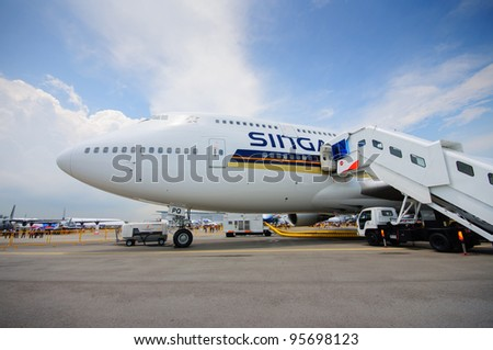 SINGAPORE - FEBRUARY 12: Singapore Airlines (SIA) showcasing its last Boeing 747-400 aircraft at Singapore Airshow February 12, 2012 in Singapore - stock photo