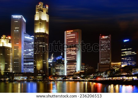 SINGAPORE - FEBRUARY 05, 2014: Singapore Boat Quay at night. Boat Quay is a historical quay in Singapore which is situated upstream from the mouth of the Singapore River on its southern bank.  - stock photo