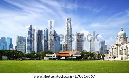 SINGAPORE - FEBRUARY 03, 2014: Singapore skyline. View includes next buildings: DBC, HSBC, Maybank, Capital, Overseas Bank, OUB, UOB Plaza One, OSBC, SingTel, One George Street, Supreme Court and ect  - stock photo