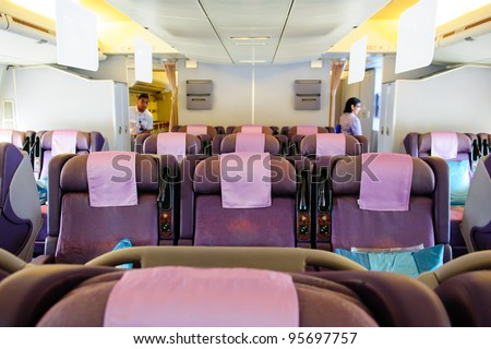 SINGAPORE - FEBRUARY 12: Spacious business class seats in Singapore Airlines' (SIA) last Boeing 747-400 aircraft at Singapore Airshow February 12, 2012 in Singapore - stock photo