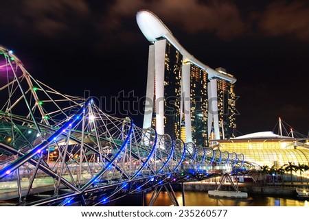 SINGAPORE - FEBRUARY 05, 2014: The Helix Bridge, Marina bay sands at night. Marina Bay Sand iconic design has transformed Singapore's skyline. Designed by architect Moshe Safdie.  - stock photo