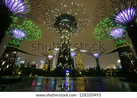 Singapore - February 14, 2013: The Supertree Grove at Gardens by the Bay in Singapore. Gardens by the Bay is a park spanning 101 hectares of reclaimed land at Marina Bay, Singapore. - stock photo