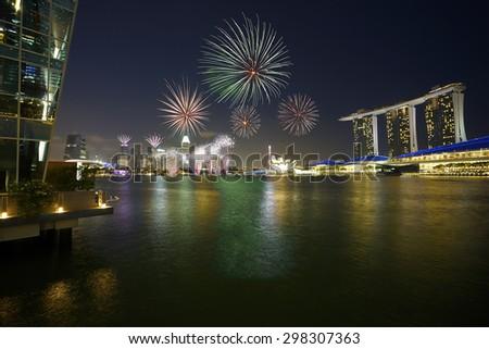 Singapore - Fireworks over Marina Bay - stock photo