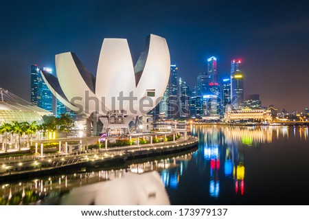 SINGAPORE - JAN 18:ArtScience Museum reflect water on JAN 18, 2014 in Singapore. It is one of the attractions at Marina Bay Sands. It has 21 gallery spaces with a total area of 6,000 square meters. - stock photo