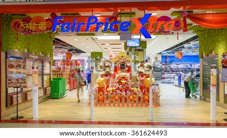 SINGAPORE-JAN 12, 2016: Entrance to FairPrice Xtra hypermarket with Chinese New Year Monkey decoration. NTUC FairPrice is the largest supermarket chain in Singapore, with over 100 stores island-wide  - stock photo