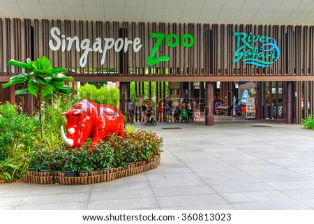SINGAPORE-JAN 10, 2016: Entrance to Singapore Zoo with red rhino sculpture from wildlife reserves. There are about 315 species of animal in the zoo, attracts about 1.7 million visitors each year - stock photo