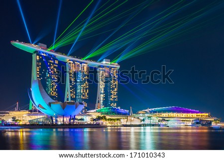 SINGAPORE -Jan 13: Largest and most beautiful laser show at the Marina Bay waterfront in Singapore. Wonderful laser show and water spectacular in Southeast Asia on Jan 13, 2014, Singapore - stock photo