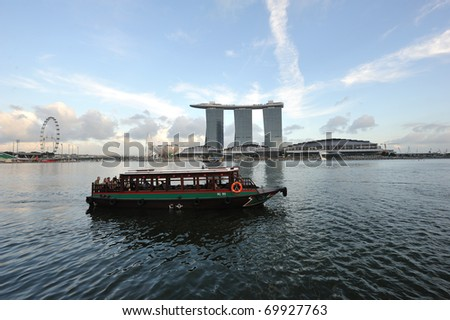 SINGAPORE - JAN 25: The Marina Bay Sands Hotel dominates the skyline at Marina Bay Jan 25, 2011 in Singapore. It is the world's most expensive standalone casino property at US$ 6.3 billion. - stock photo