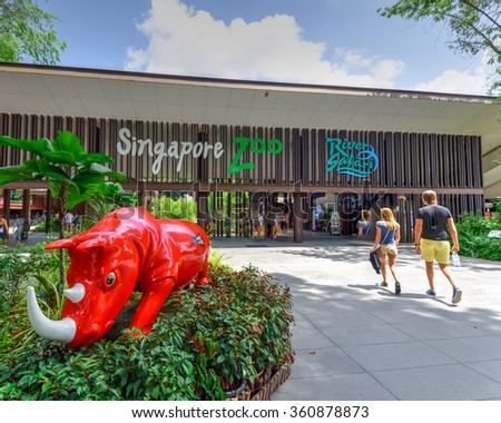 SINGAPORE-JAN 10, 2016: Visitors entering the Singapore Zoo, or Zoological Gardens. There are about 315 species of animal in the 28 hectares (69 acres) zoo, attracts about 1.7 million visitors peryear - stock photo