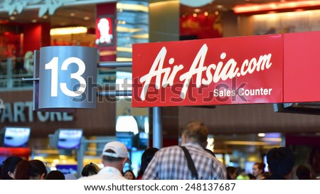 SINGAPORE - JANUARY 10:  AirAsia sales counter at Changi Airport on January 10, 2015 in Singapore - stock photo