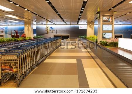 SINGAPORE - JANUARY 6: Changi International Airport on January 6, 2014 in Singapore. Singapore airport is the main aviation hub in Southeast Asia, handling 66 million passengers per year. - stock photo