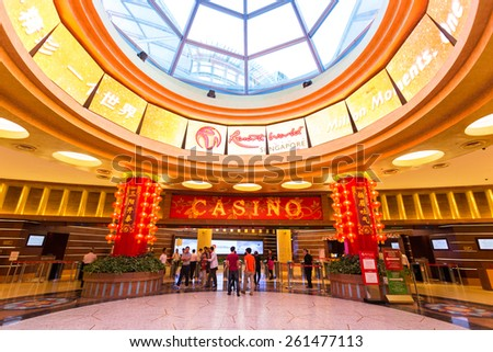 SINGAPORE - JANUARY 30, 2015 :  Interior hall at the casino at Resorts World Sentosa. Resort World Sentosa is an integrated resort on the Sentosa island featuring Universal studio and casino. - stock photo