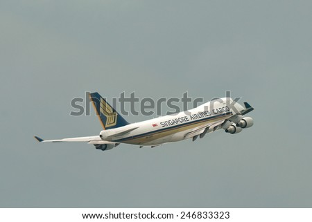 SINGAPORE - JANUARY 10: Singapore Airlines Cargo Boeing 747-400F freighter taking off at Changi Airport on January 10, 2015 in Singapore - stock photo