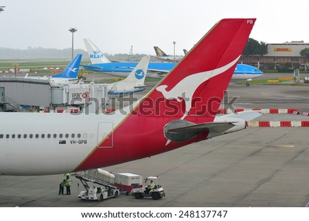 SINGAPORE - JANUARY 10:  Tail of Qantas Airbus 330 at Changi Airport on January 10, 2015 in Singapore - stock photo