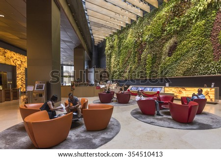 Singapore, 29 January 2015, Tourist and Businessman in a hotel lobby, Marina Bay, Singapore - stock photo