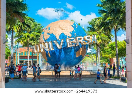 SINGAPORE - JANUARY 13 Tourists and theme park visitors taking pictures of the large rotating globe fountain in front of Universal Studios on January 13, 2015 in Sentosa island, Singapore - stock photo