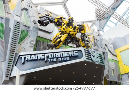 SINGAPORE - JANUARY 30,2015 : TRANSFORMERS The Ride: The Ultimate 3D Battle The statue of Autobot robot  at Sci-Fi City, Universal Studio, Singapore  - stock photo