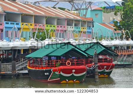 SINGAPORE - JULY 10 : Clarke Quay on July 10, 2012 in Singapore. Clarke Quay, is a historical riverside quay in Singapore, located within the Singapore River Planning Area. - stock photo
