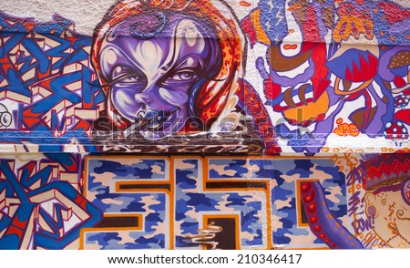 SINGAPORE - JULY 24: Graffiti Wall next to a Singapore Art Museum on July 24, 2014 in Singapore.  - stock photo
