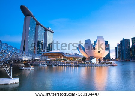 Singapore - July 10:  Marina Bay Sands Hotel, ArtScience Museum, Helix Bridge at July 10, 2013. - stock photo
