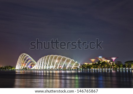 SINGAPORE - JULY 20: Night view of Flower Dome at Gardens by the Bay on July 20, 2013 in Singapore. Spanning 101 hectares of reclaimed land in central Singapore, adjacent to the Marina Reservoir.  - stock photo