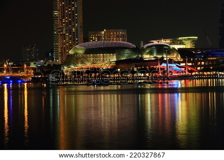 SINGAPORE - July 12: Night View of skyscrapers in Marina Bay on July 12, 2014 in Singapore. Singapore is the world's fourth leading financial center.  - stock photo