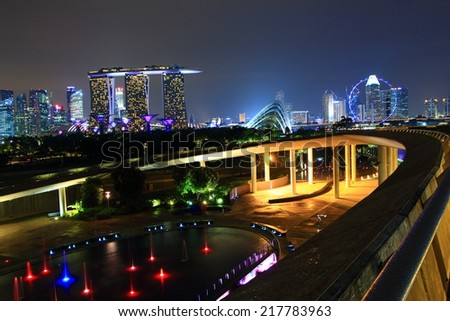 SINGAPORE - July 12: Night view of The Marina Bay Sands Resort Hotel on July 12, 2014 in Singapore. It is an integrated resort and the worlds most expensive standalone casino property at S$8 billion.  - stock photo