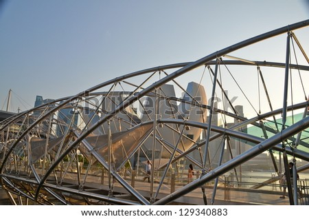 SINGAPORE - JULY 26: The Helix Bridge on July 26, 2012 in Singapore. It is a pedestrian bridge linking Marina Centre with Marina South in the Marina Bay area in Singapore, designed as a DNA molecule. - stock photo
