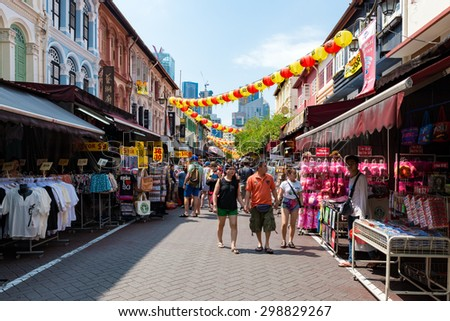 SINGAPORE - JULY 10: Tourists shopping at traditional China Town market place on July 10, 2015 at Singapore. Singapore's Chinatown is a world famous bargain shopping destination. - stock photo