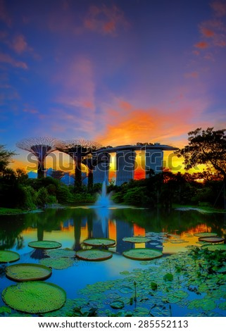 SINGAPORE-JUN 07: Evening view of Water Lily pond, and Marina Bay Sands at Gardens by the Bay on Jun 07, 2015 in Singapore. Spanning 101 hectares of reclaimed land in central Singapore. - stock photo