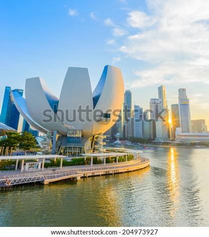 SINGAPORE - JUNE 24: ArtScience Museum on JUNE 24, 2014 in Singapore. It is one of the attractions at Marina Bay Sands. It has 21 gallery spaces with a total area of 6,000 square meters. - stock photo